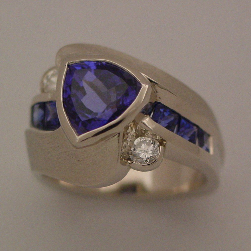 14k White Gold Tanzanite Trillion Center and Sapphire Channel Set on sides