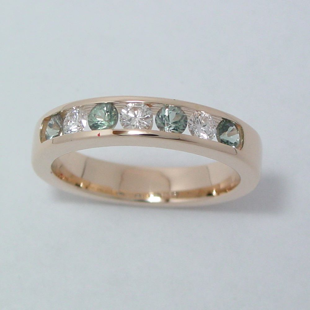 14k Yellow Gold Channel Set Diamond and Green Sapphire Ring